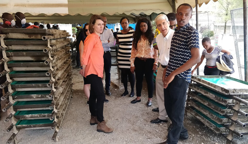 Peter Salovey touring the Sanergy manufacturing plant in Nairobi, Kenya.