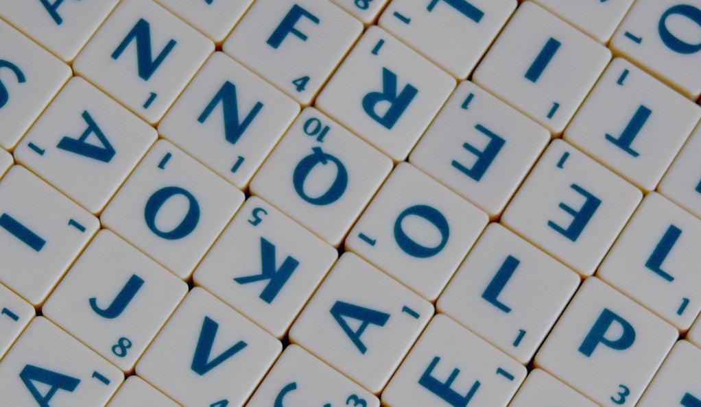 A closeup photo of several lettered tiles arranged randomly.