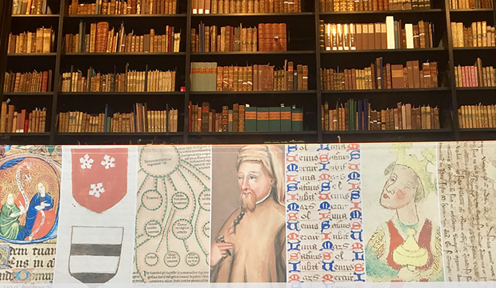 A sign in the lobby of Yale's Beinecke Library promoting an exhibition of the Takamiya collection of rare medieval manuscripts.