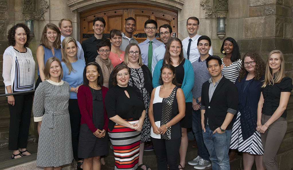 A group of CTL staff and teaching fellows pose outside the library.