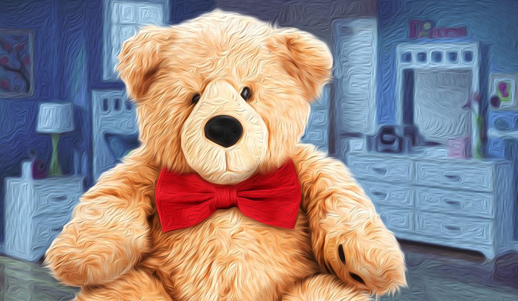 A teddy bear with a red bow tie