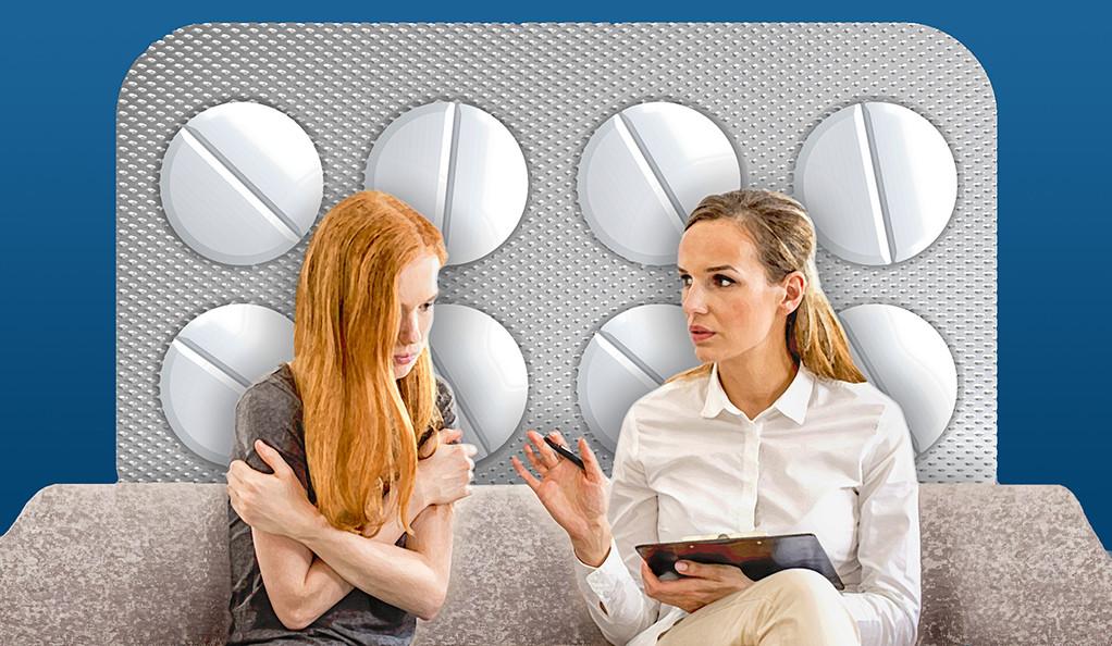 An illustration of a female therapist counseling a young female in front of a large blister pack of pills.