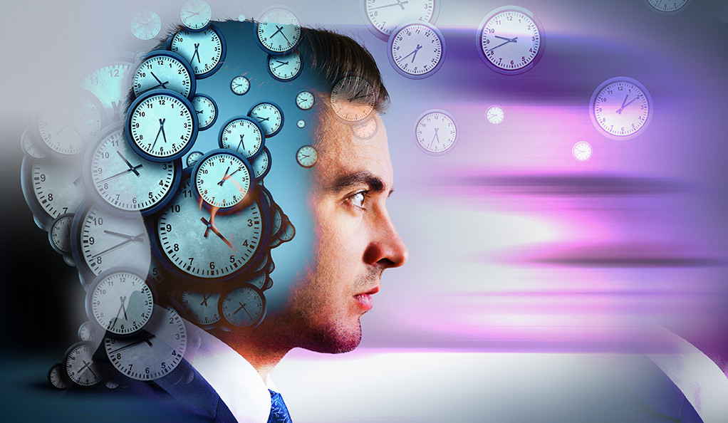 A stylized graphic of several clocks and the profile of a male.
