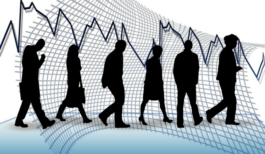 An illustration showing the silhouettes of several people with an economic chart behind.
