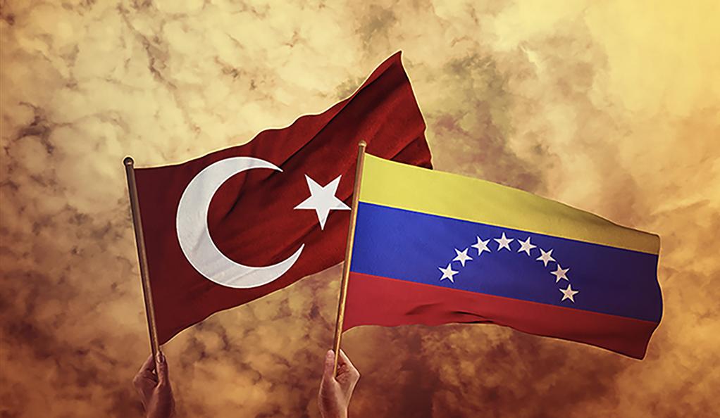 Turkish and Venezuelan flags held aloft