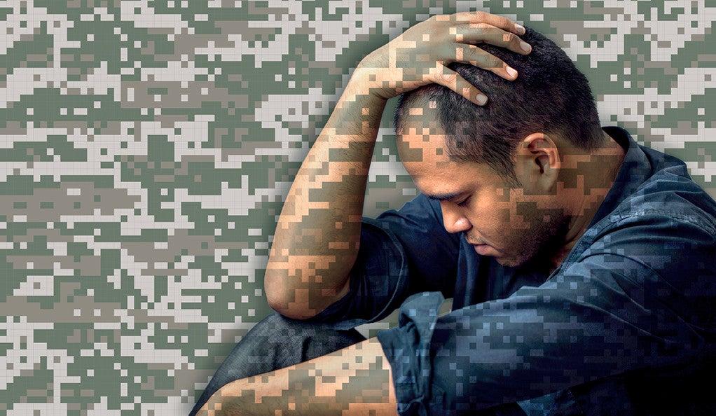 An anxious man cradles his head.