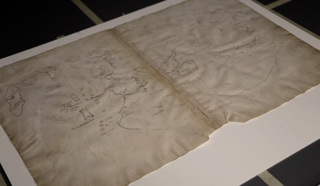 The Vinland Map laid out on a table.