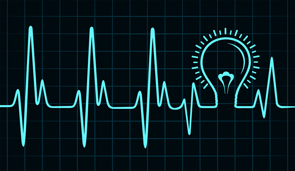 A heart-monitor pulse with the shape of a lightbulb in the middle.
