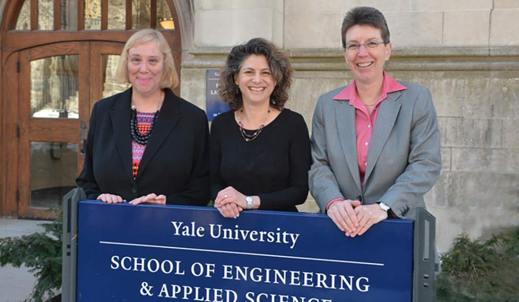 Yale computer science faculty posing in front of the department building.