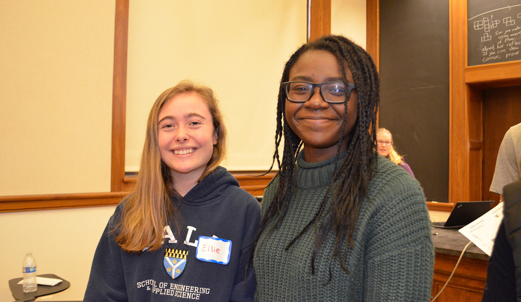 Two young female students posing for a photo at the College Decision Panel, hosted by STEM Mentors at Yale.