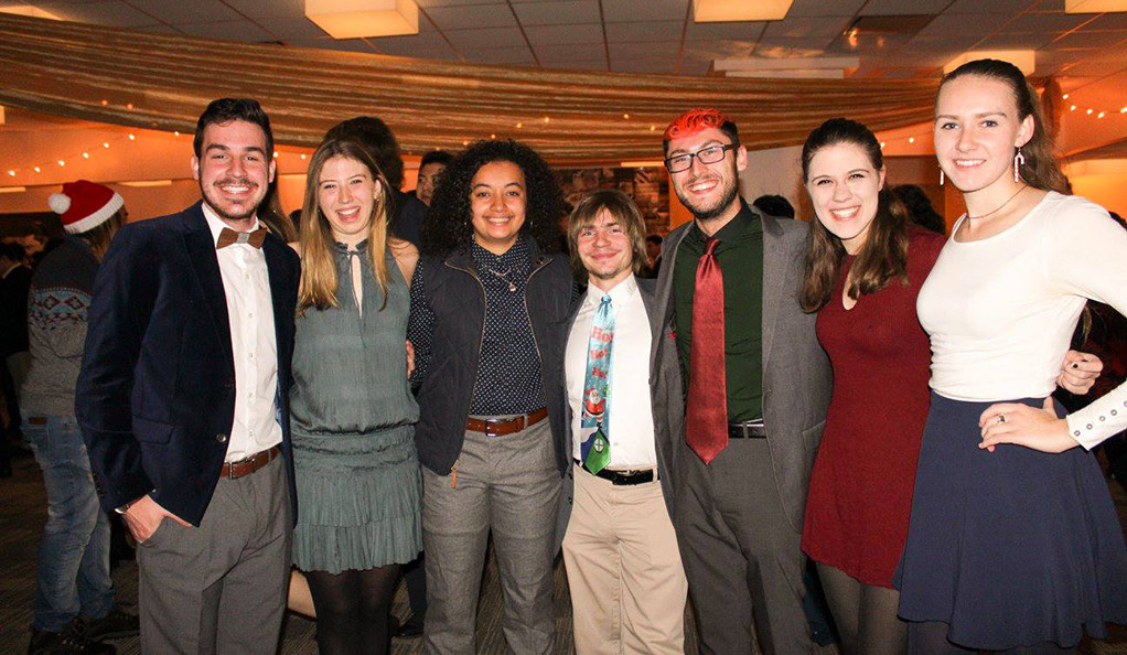 A group of Yale students pose at the annual First-Year Holiday Dinner.