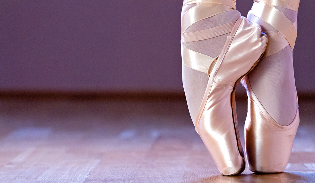close-up of a ballerina's feet on tip-toes