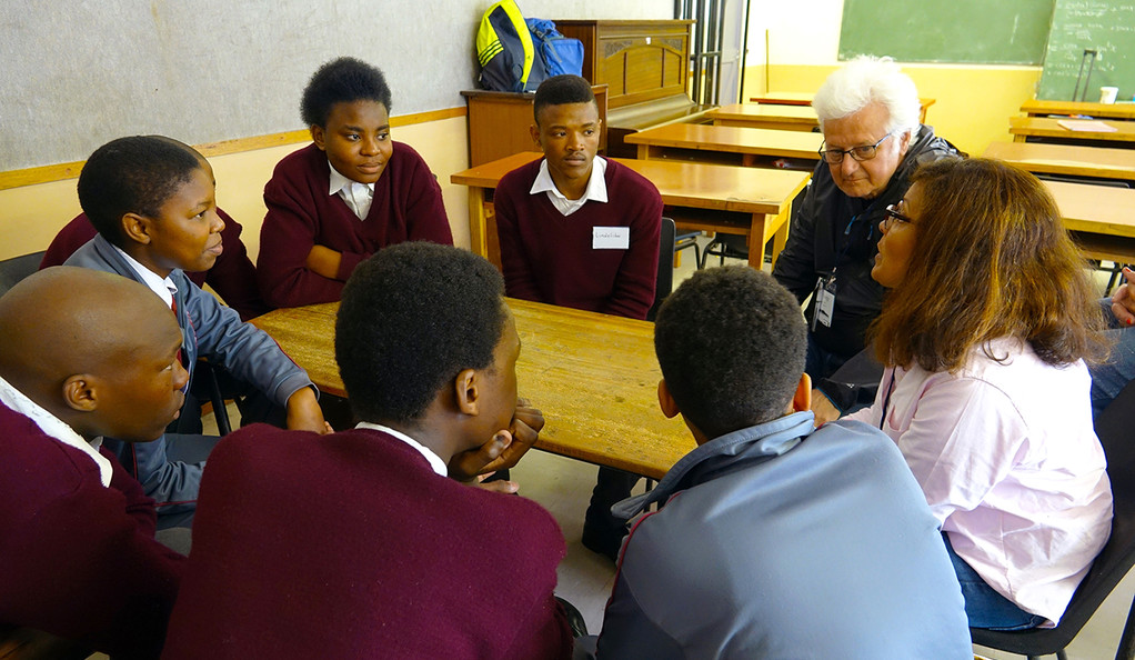 Two Yale alumni speak to 10th graders in South Africa as part of a tutoring program.