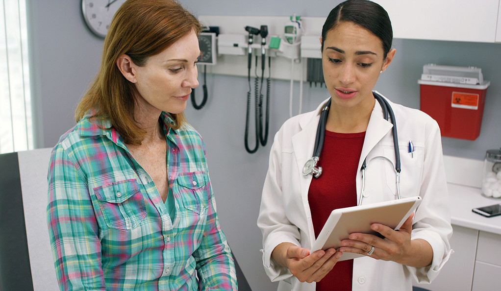 woman meeting with her doctor