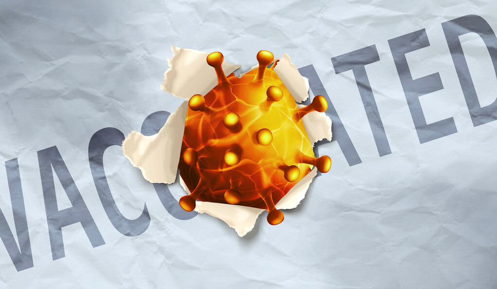 """A COVID-19 virus breaking through a screen that says """"vaccinated."""""""