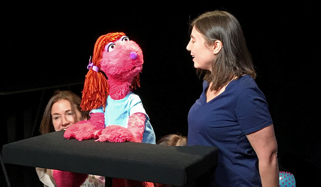 Violet the puppet and a female actor