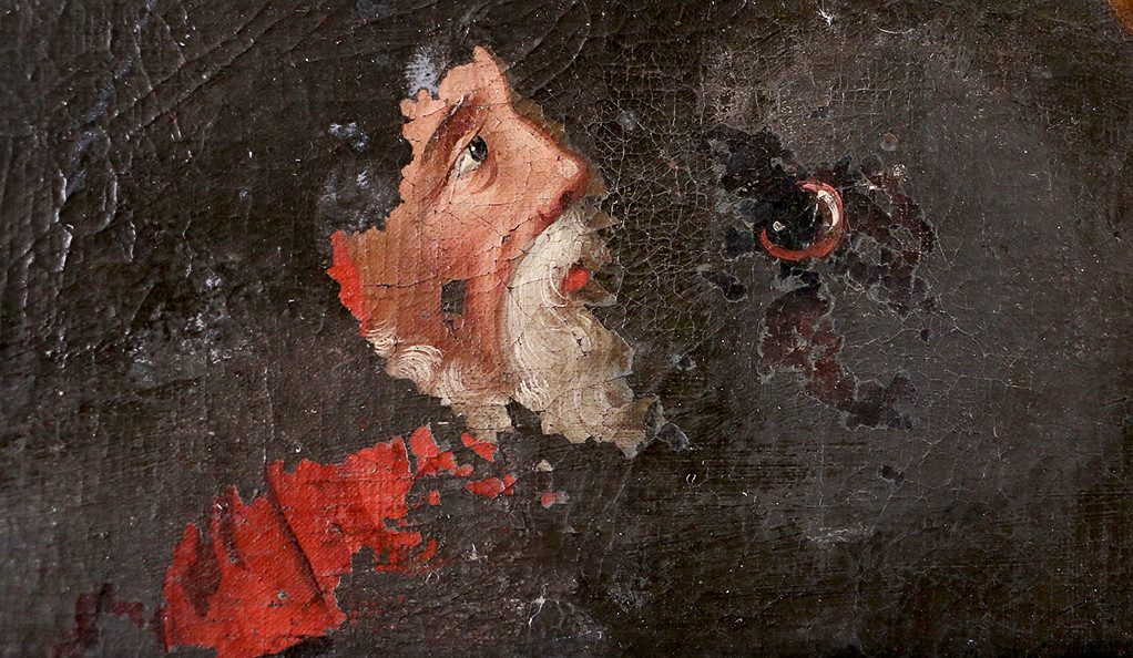 A Roman Catholic cardinal emerges from underneath a layer of over-paint in a 17th-century painting.