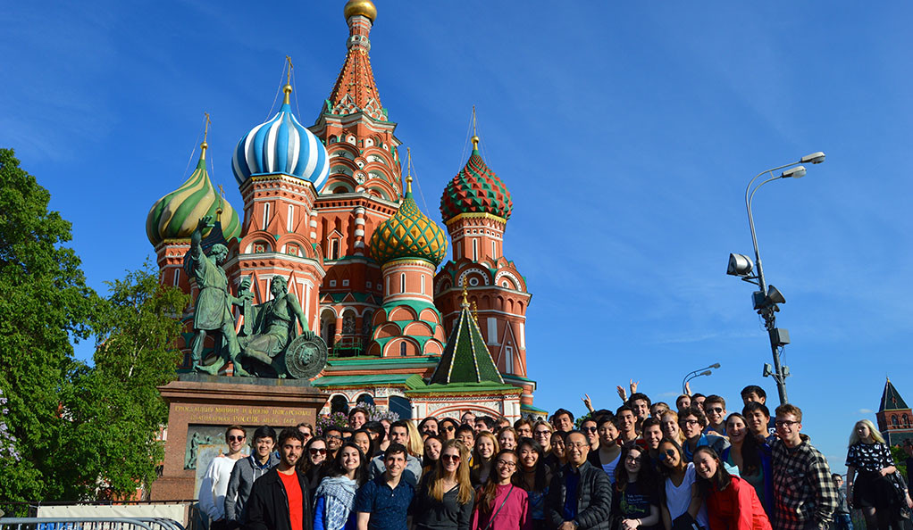 Members of the Yale Symphony Orchestra pose in front of St. Basil's Cathedral in Moscow's Red Square.