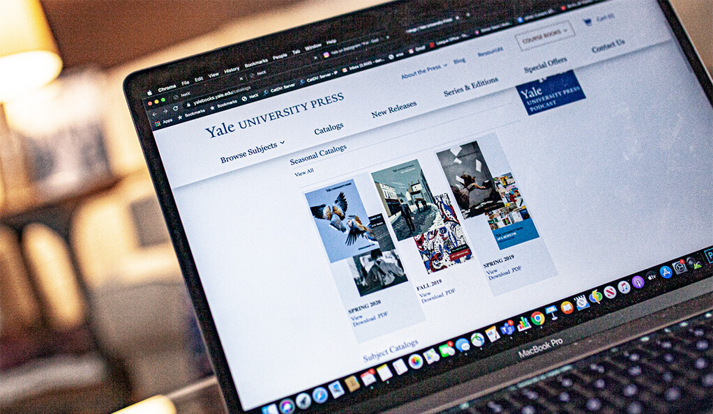 A laptop with the Yale University Press catalog displayed