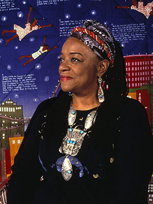 Faith Ringgold in front of her piece, Tar Beach 2.