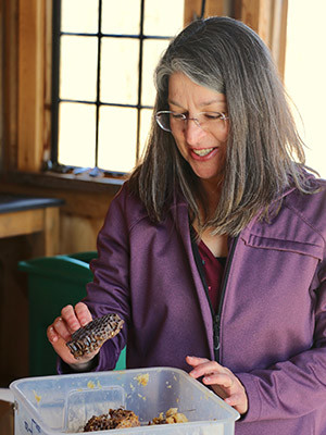 Susan Ernst with a honeycomb.