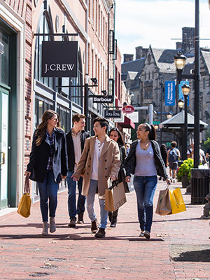 A group of young people shopping on Broadway in New Haven.