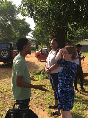 Yale student Mikaela Rabb and Dr. Talbert-Slagle talking with Jesse Colendo, a Liberian medical student in October 2017.