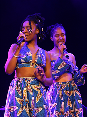 A pair of singers during a Africa Salon festival performance.