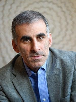 A portrait photo of Alan Mikhail