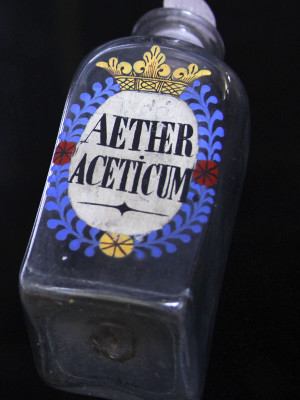 An apothecary bottle that contained aether aceticum, once a cure for flatulence and now a common paint thinner.