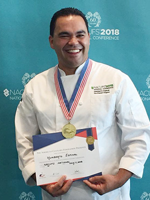Chef Humberto Espinal with his first-prize medal and certificate.