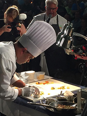 Yale chef Humberto Espinal preparing a meal at the Culinary Challenge