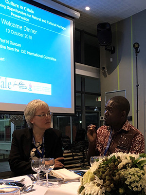 Elisabeth Wolbers talks with Fredrick Nsibambi during the opening dinner of the Culture in Crisis Conference.