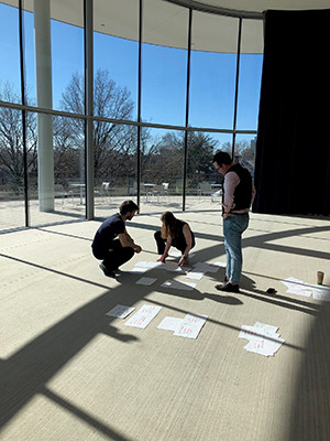Phil Corlett  leads a design workshop with two Yale School of Management students.