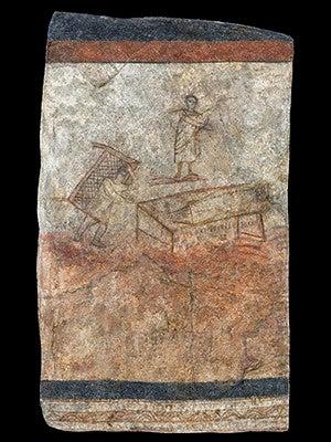 An ancient wall illustration of Jesus healing a bedridden man.