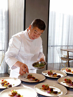 Chef Ren Jinsuo plates a plant-based Lunar New Year dish.