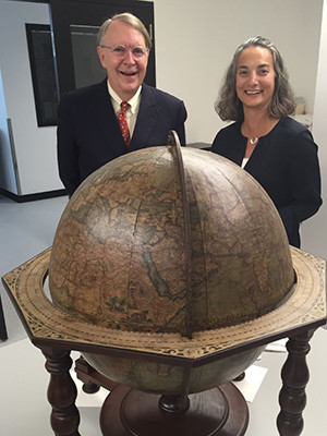Stephen F. Gates and Susan Gibbons standing with Coronelli Globe.