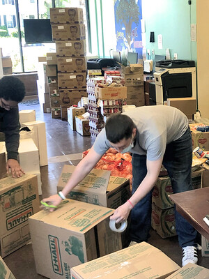 Men packing boxes with food