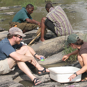 Post in the field taking river samples