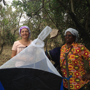 Askoy and Dr. Grace Murilla standing alongside a tsetse trap.