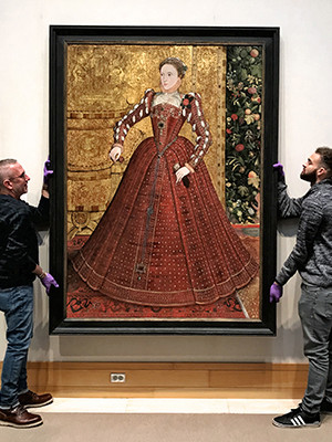 The earliest known full-length portrait of Queen Elizabeth I being installed on the fourth floor of the YCBA