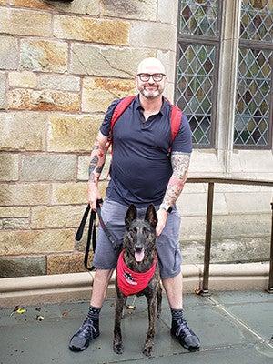 "James ""Jimmy"" Hatch with his service dog, Mina"