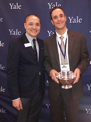 Glen Gechlik receiving a Yale Leadership Award from the Yale Alumni Association with Henry Kwan.