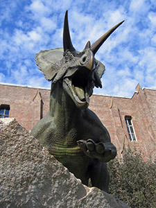 A statue of a dinosaur outside the Yale Peabody Museum of Natural History.