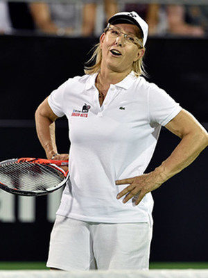 Martina Navratilova standing on court with hands on hips