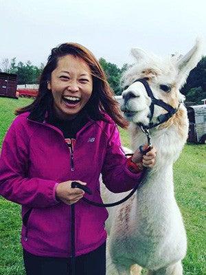 Yukari Suzuki posing with a llama.