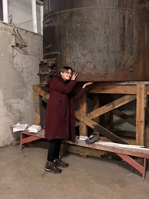 A woman in an abandoned herring factory.