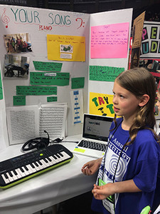 This year's Samuel Morse Prize winner, Lila Fellows Easton, Connecticut, shows off her invention.