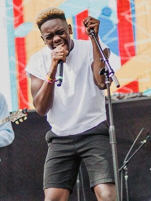 Xavier Washington singing on stage.