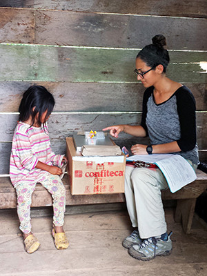A Shuar child plays a game to test her patience and risk-aversion.